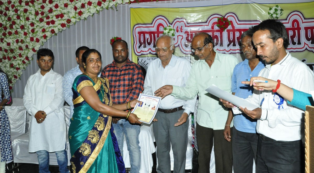 Senior social worker giving social service honor to rural women